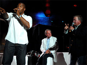 Marc Dreier (center) with football ex-player Michael Strahan and actor William Shatner. No, really. Notice how this photo really plays up Dreier's Ommpa Loompa ancestry.