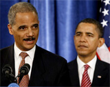 Eric Holder (left), Barack Obama