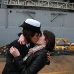 Two Women Enjoy First Kiss at Port for Navy Ship Return