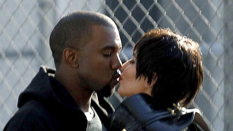 Kim Kardashian and Kanye West Caught Kissing on Camera
