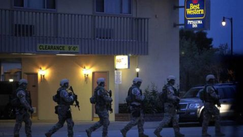 Three Federal Agents Shot in Gang Raid