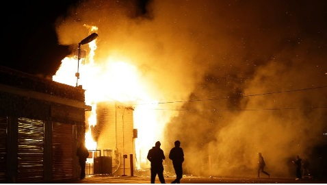 Dozens of Buildings Burn after Ferguson Verdict Reached