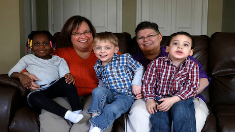 April DeBoer, Jayne Rowse, and their three children.