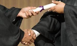 college graduation handshake