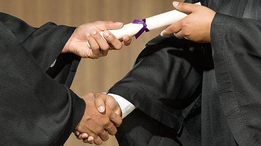 college graduation handshake