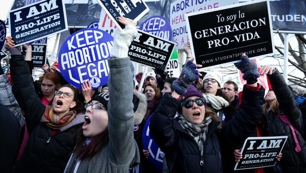 WASHINGTON, DC - JANUARY 22:  Pro-life activists try to block pro-choice activists as the annual March for Life passes by in front of the U.S. Supreme Court January 22, 2015 in Washington, DC. Pro-life activists gathered in the nation's capital to mark the 1973 Supreme Court  Roe v. Wade decision that legalized abortion.  (Photo by Alex Wong/Getty Images)
