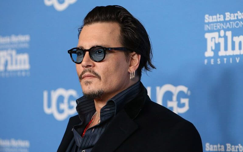 "Johnny Depp Accuses Ex-Managers of ""Smear"" Campaign"