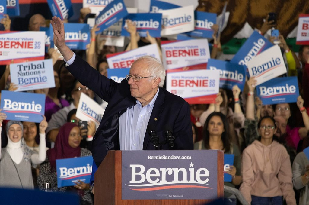 Sanders campaigning for President in San Jose, California, March 2020 Photo by Σ -Wikimedia Commons